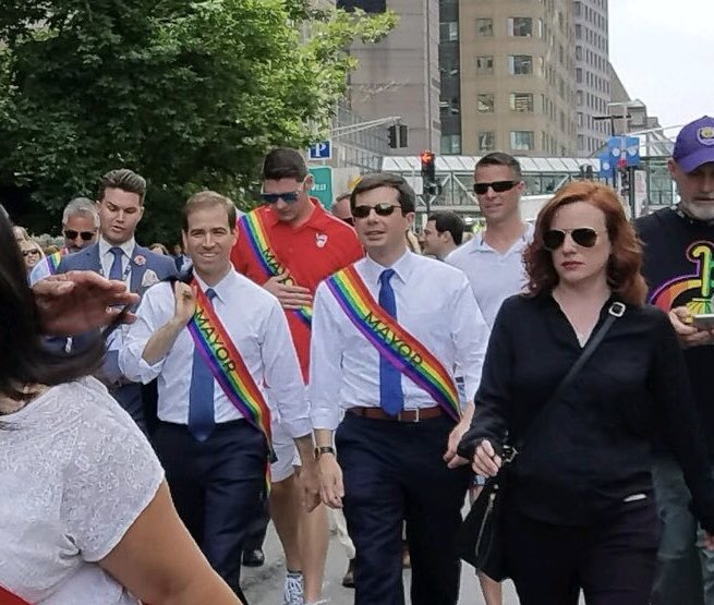 Pete marches with other gay mayors in a Pride parade.