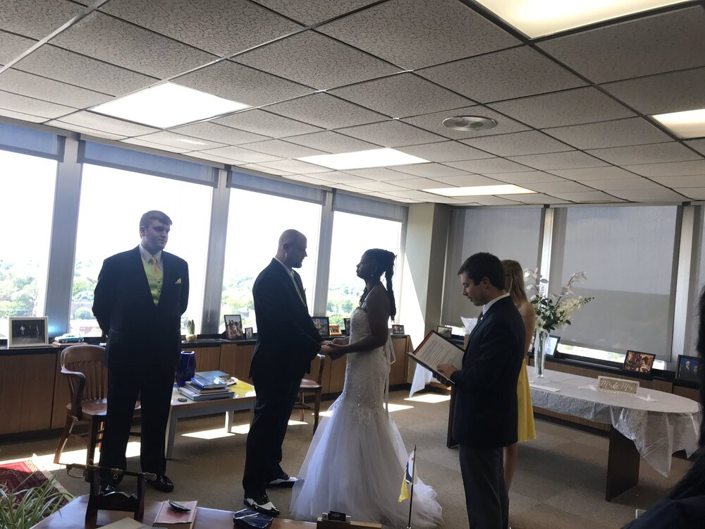 Performing one of many wedding ceremonies in the mayor's office. Posted by Laura O'Sullivan.