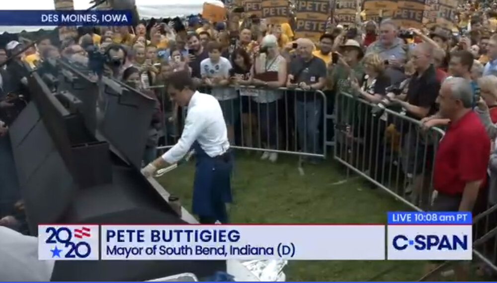 Pete grilling steaks. C-Span Still