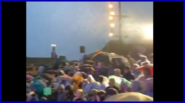 VIDEO: Crowd pan in Waterloo. Large crowd in the rain.